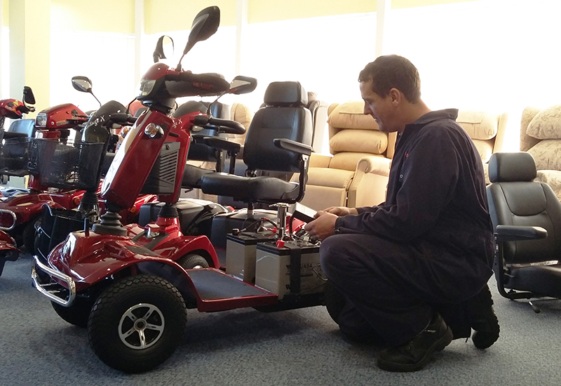 Electric Mobility James Tucker programing a Rascal Pioneer – training course CROP